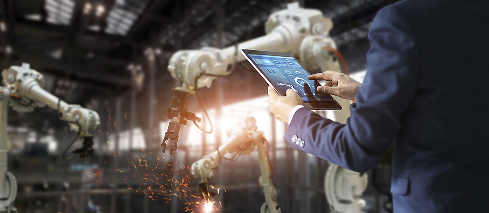 manager-industrial-engineer-using-tablet-check-and-control-automation-robot-arms-machine(1)